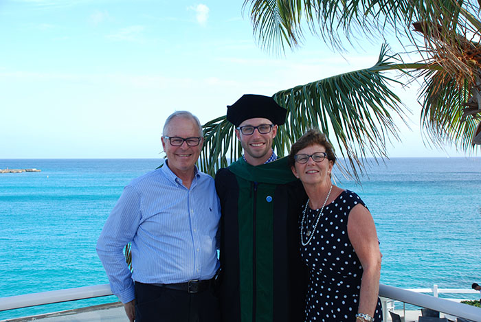 Vlad Haltigin, Cathy Stewart and their son, AUC graduate Chris Haltigin