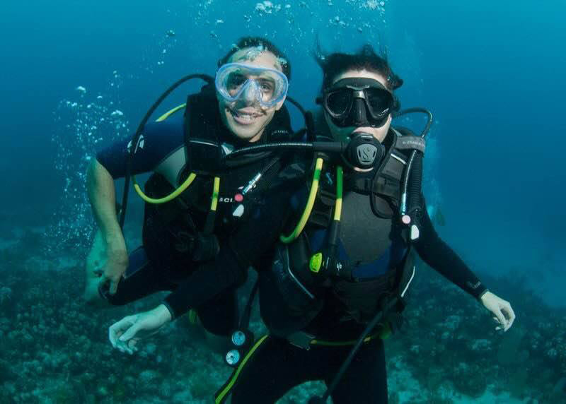 AUC alumni Dr. Tabaac and wife, Vanessa, scuba diving