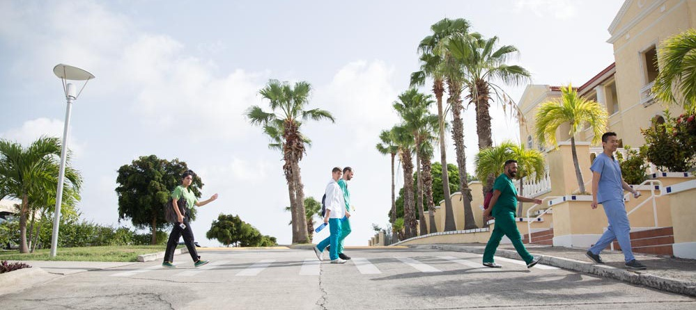 AUC medical program students walking to class on the AUC campus