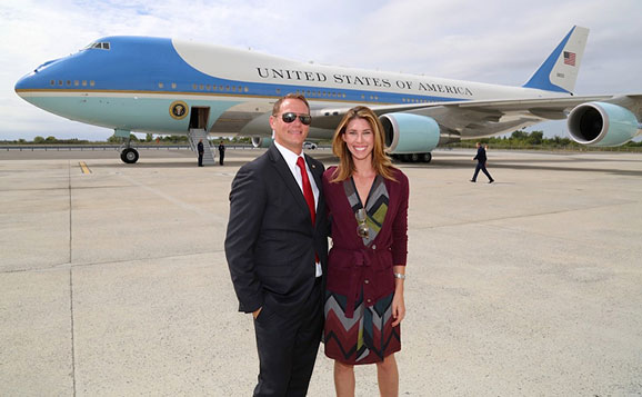Dr. Christopherson and her husband Max in front of Air Force One at JFK airport