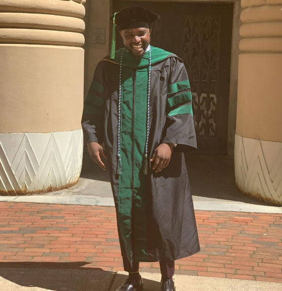 A man smiling on graduation day