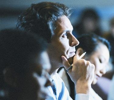 Photo of a man listening at Medical Conference
