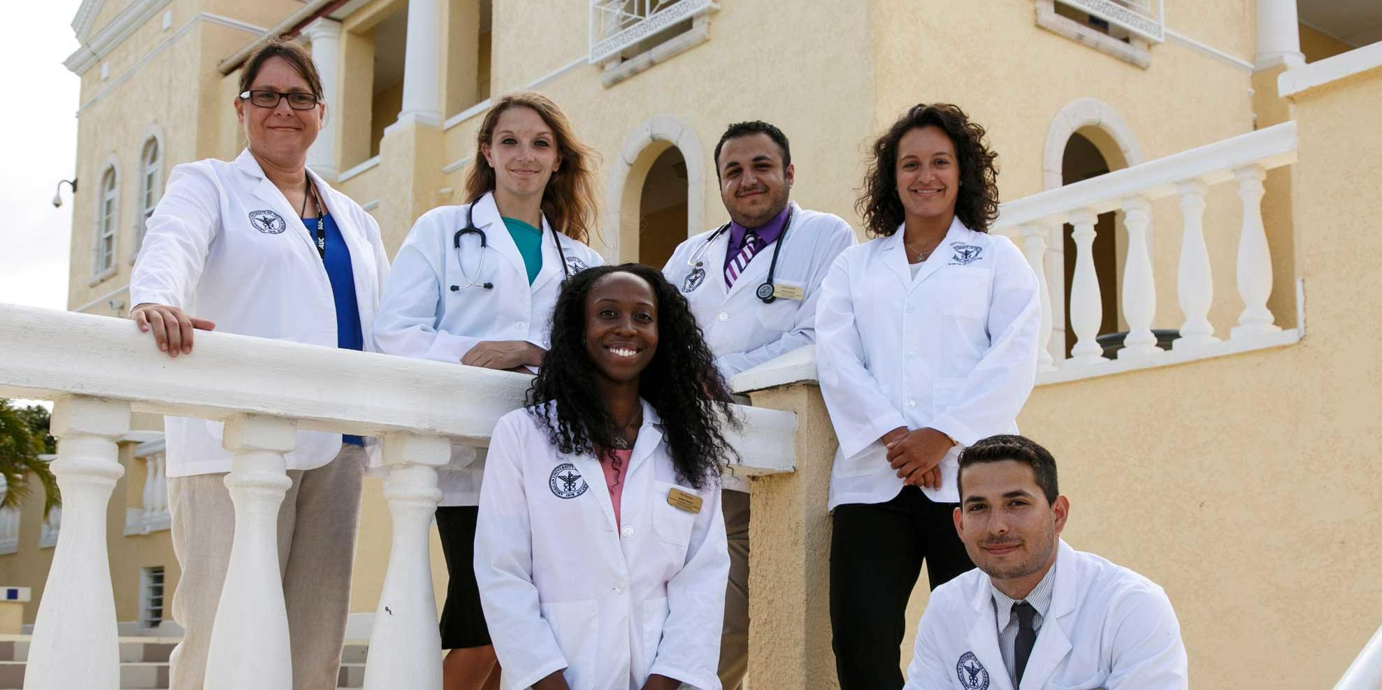 Group picture of AUC students in white coats