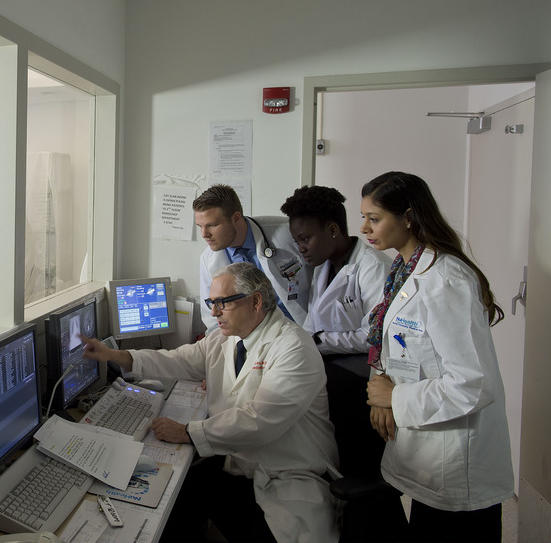 Doctors looking at computer screens