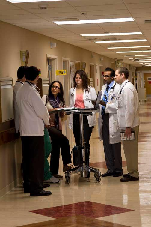 Doctors working together in hallway